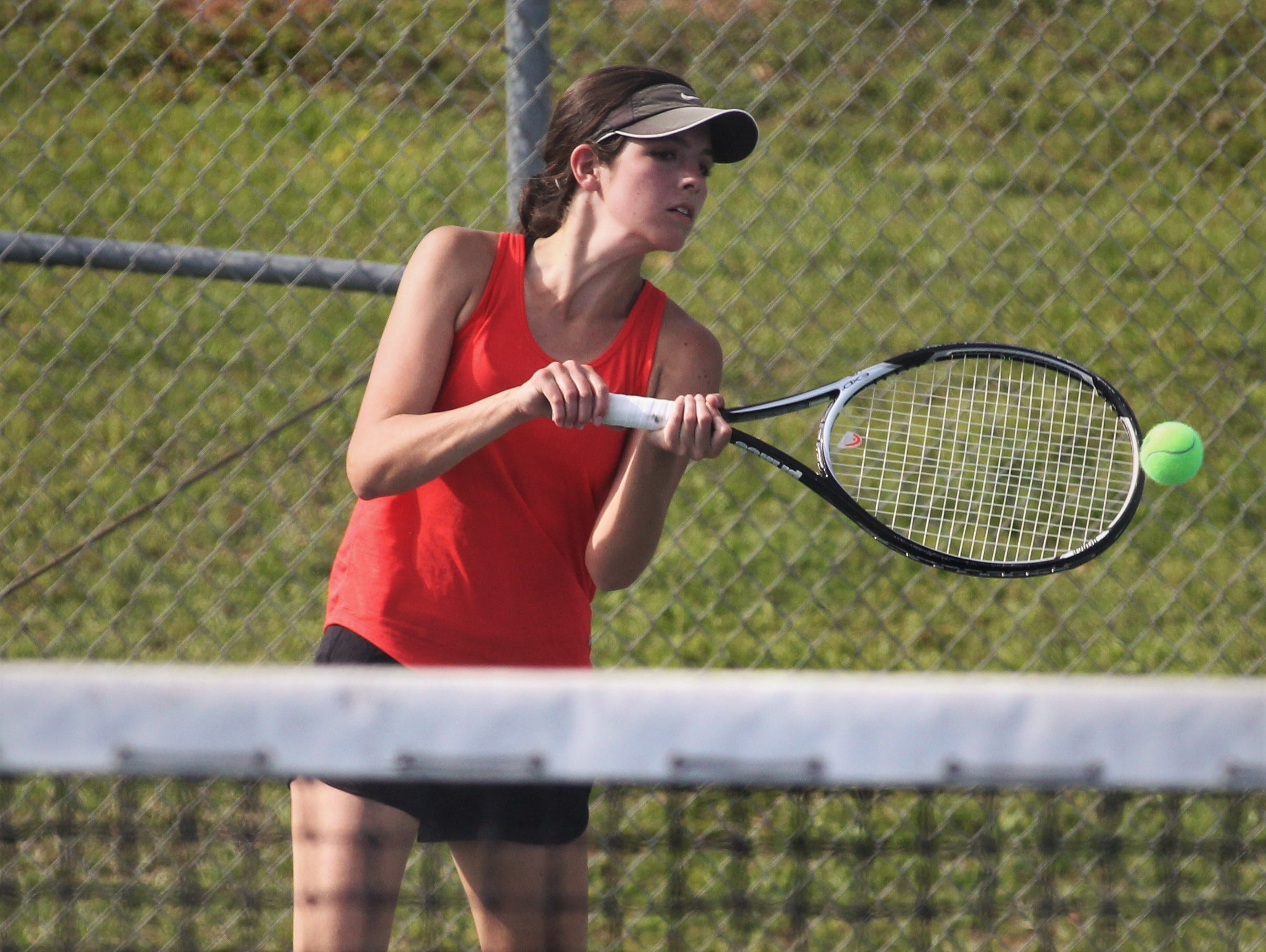 Leon senior Carsyn Kenny plays during the boys and girls tennis city tournament at Tom Brown Park on March 13, 2019.