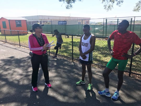 FAMU tack and field coach Darlene Moore talks with long-distance runners Festus Kemboi (center) and Fredrick Kipyego during practice on March 12, 2019. Both men are looking for championship times at the FAMU Relays March 15-16.