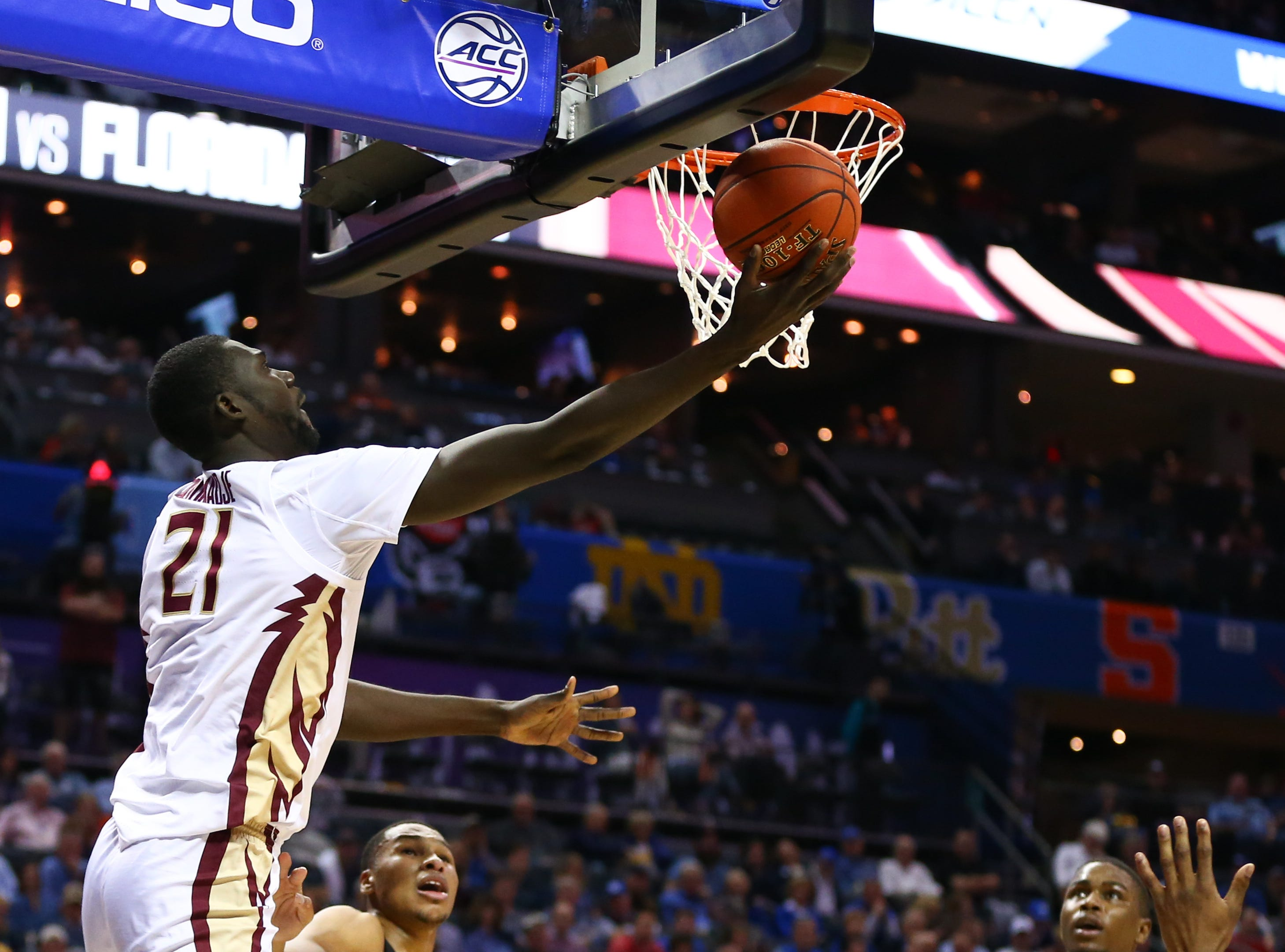 Mar 14, 2019; Charlotte, NC, USA; Florida State Seminoles center Christ Koumadje (21) shoots the ball against the Virginia Tech Hokies in the first half in the ACC conference tournament at Spectrum Center. Mandatory Credit: Jeremy Brevard-USA TODAY Sports