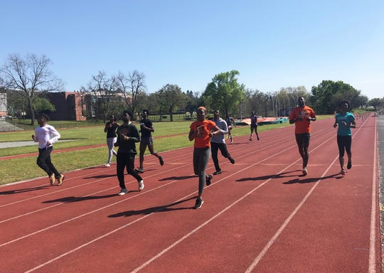 Members of the FAMU track and field team warm-up during practice on March 12, 2019.