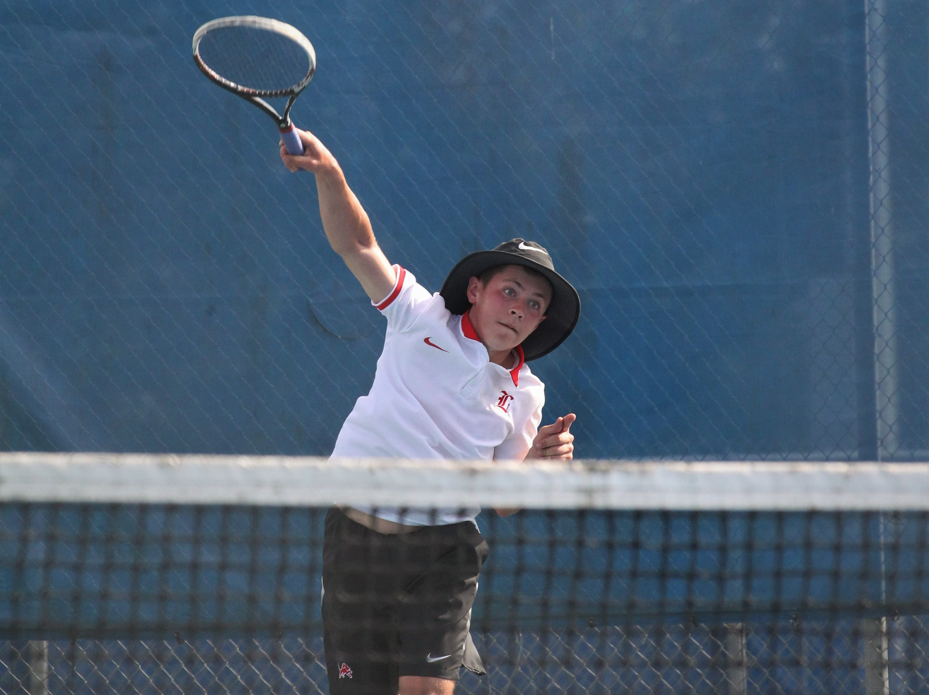 Leon's Jack Long plays during the boys and girls tennis city tournament at Tom Brown Park on March 13, 2019.