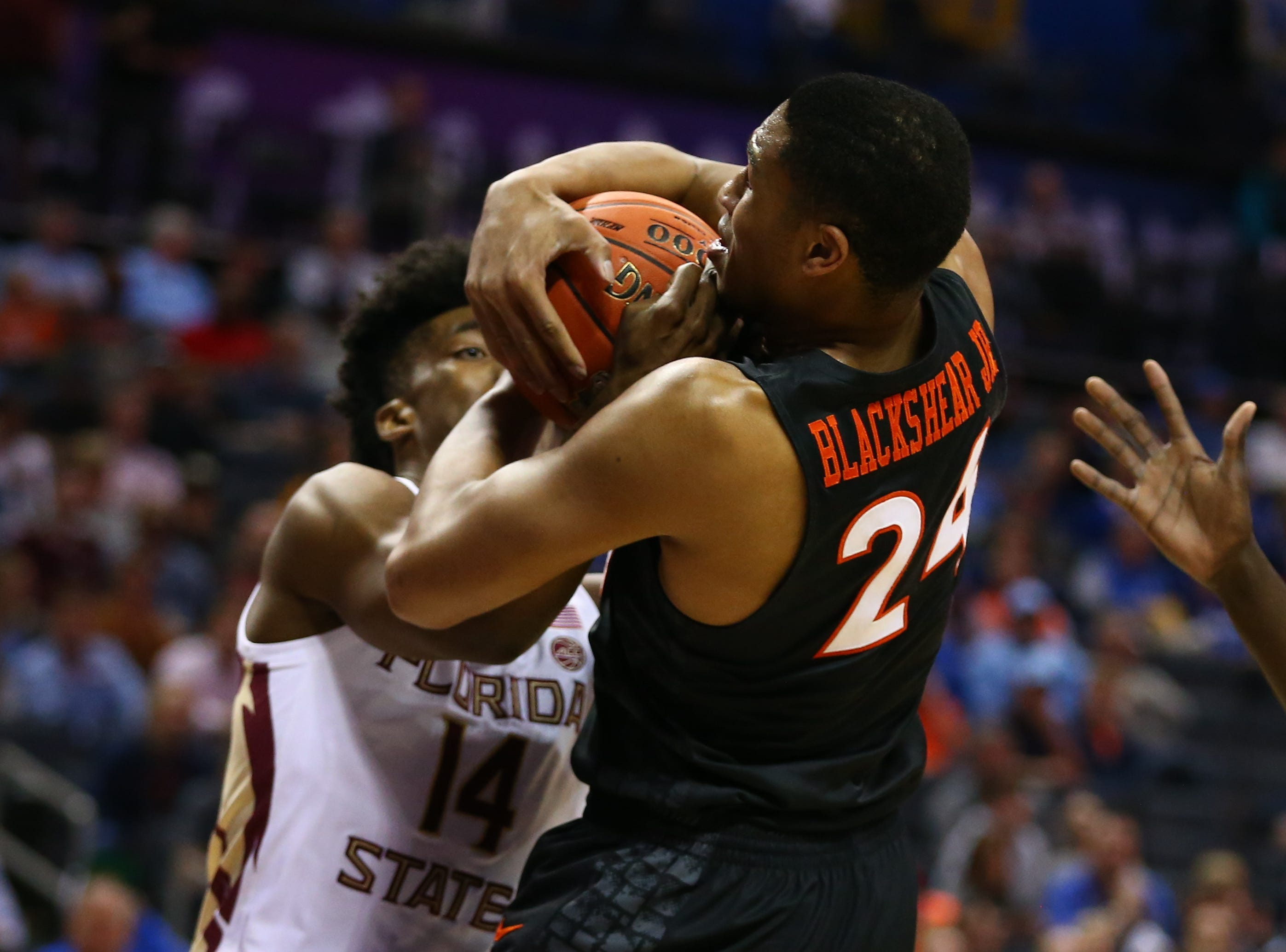 Mar 14, 2019; Charlotte, NC, USA; Virginia Tech Hokies forward Kerry Blackshear Jr. (24) and Florida State Seminoles guard Terance Mann (14) fight for possession in the first half in the ACC conference tournament at Spectrum Center. Mandatory Credit: Jeremy Brevard-USA TODAY Sports