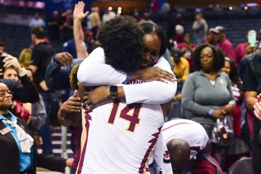 Senior forward Terrance Mann celebrates with his mom after Florida State's 65-63 overtime victory over Virginia Tech in the ACC Quarterfinals in Charlotte on Thursday.