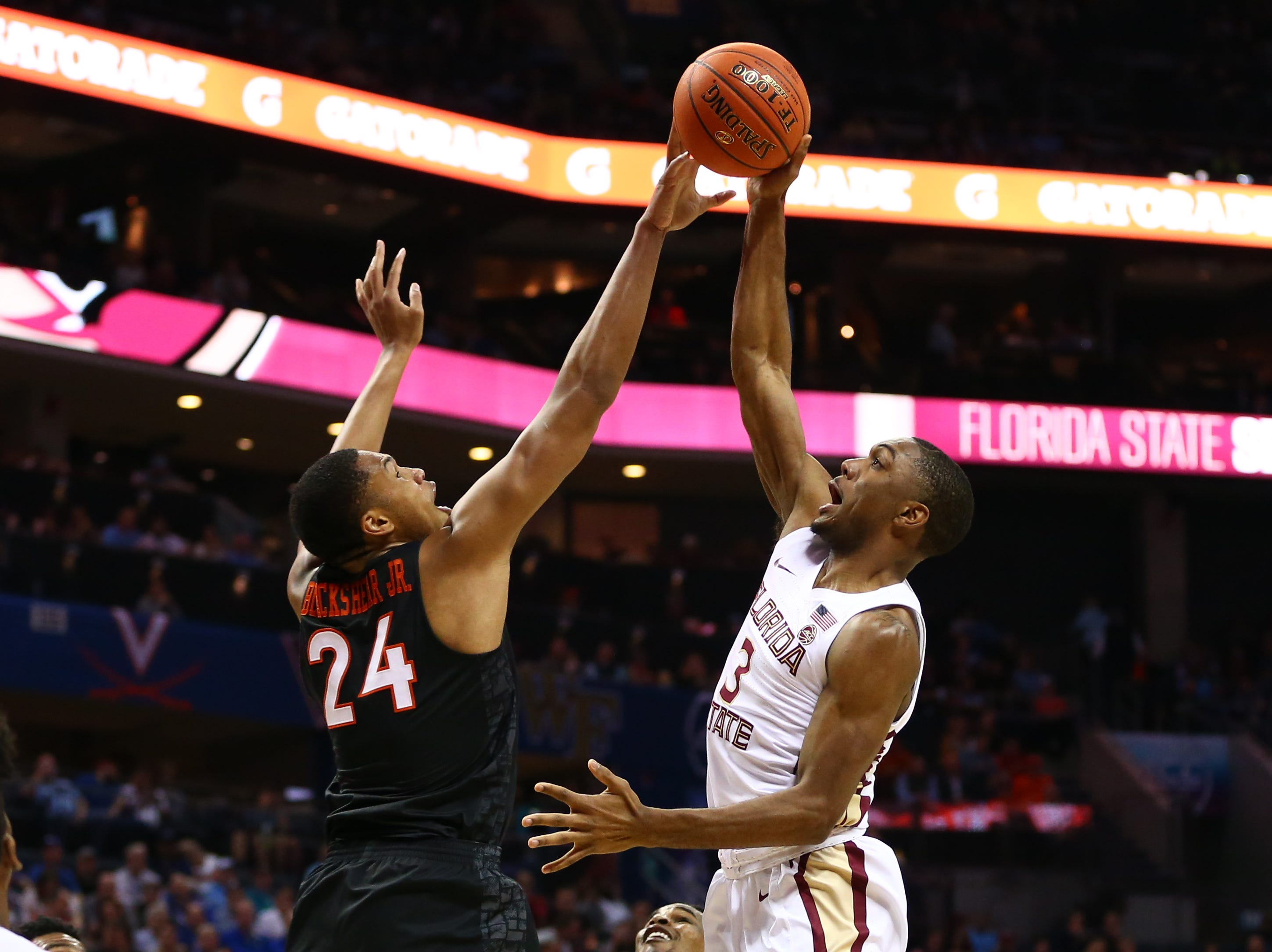 Mar 14, 2019; Charlotte, NC, USA; Florida State Seminoles guard Trent Forrest (3) shoots the ball against Virginia Tech Hokies forward Kerry Blackshear Jr. (24) in the first half in the ACC conference tournament at Spectrum Center. Mandatory Credit: Jeremy Brevard-USA TODAY Sports