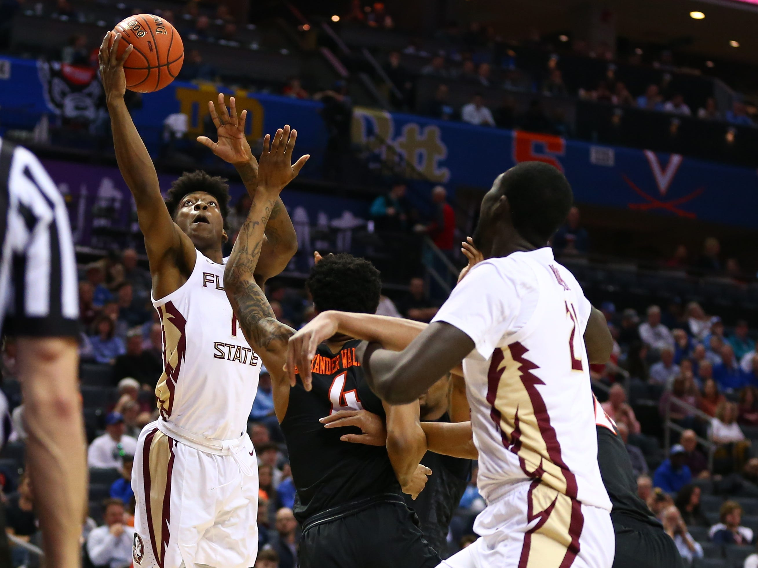 Mar 14, 2019; Charlotte, NC, USA; Florida State Seminoles guard Terance Mann (14) shoots the ball against Virginia Tech Hokies guard Nickeil Alexander-Walker (4) in the first half in the ACC conference tournament at Spectrum Center. Mandatory Credit: Jeremy Brevard-USA TODAY Sports