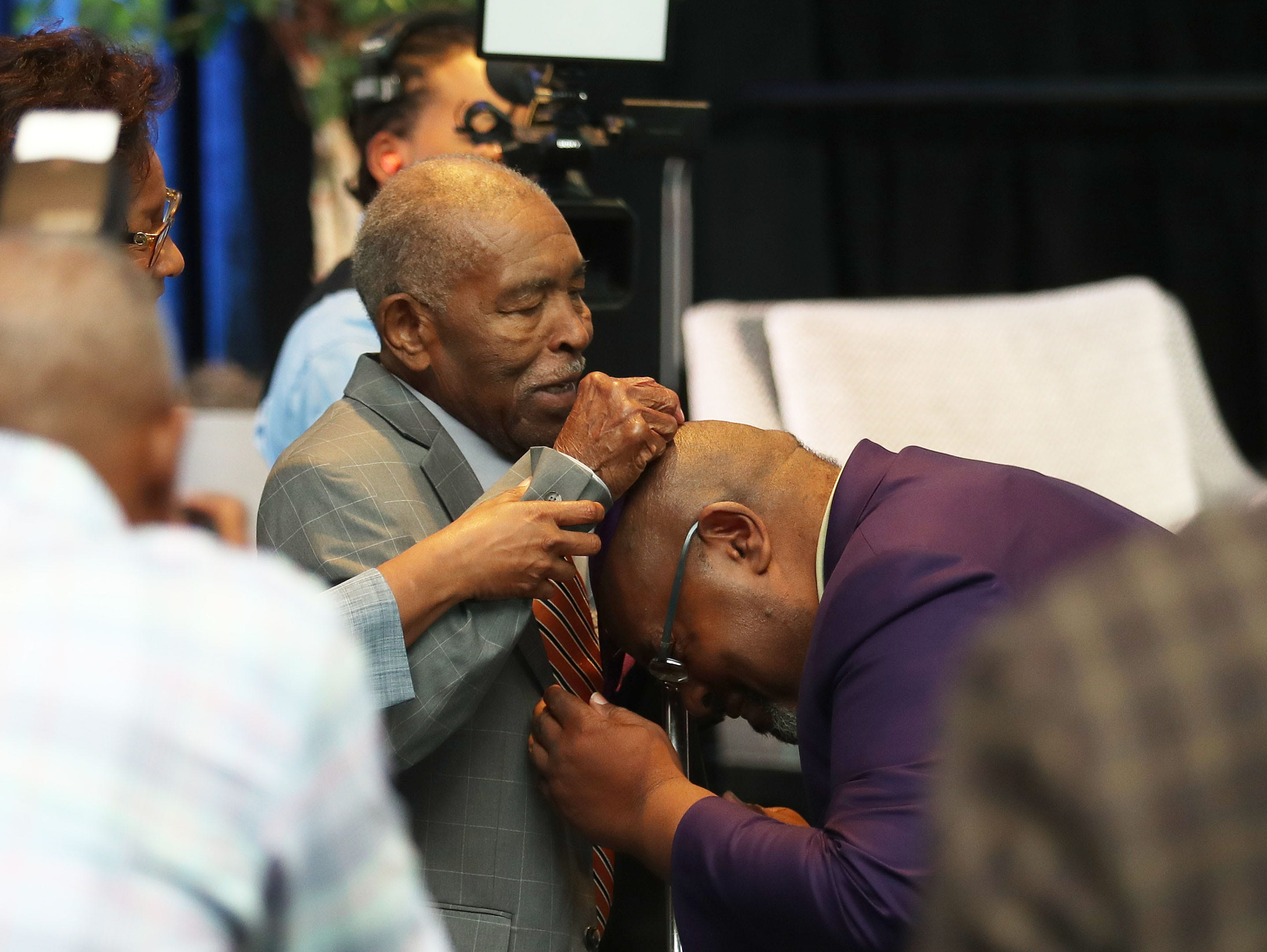 Alvin Hollins, Sr. drapes a medallion over his son, Alvin, Jr. during the MEAC Hall of Fame enshrinement on Wednesday, March 14, 2019 at the Sheraton Norfolk Waterside Hotel in Norfolk, Virginia.
