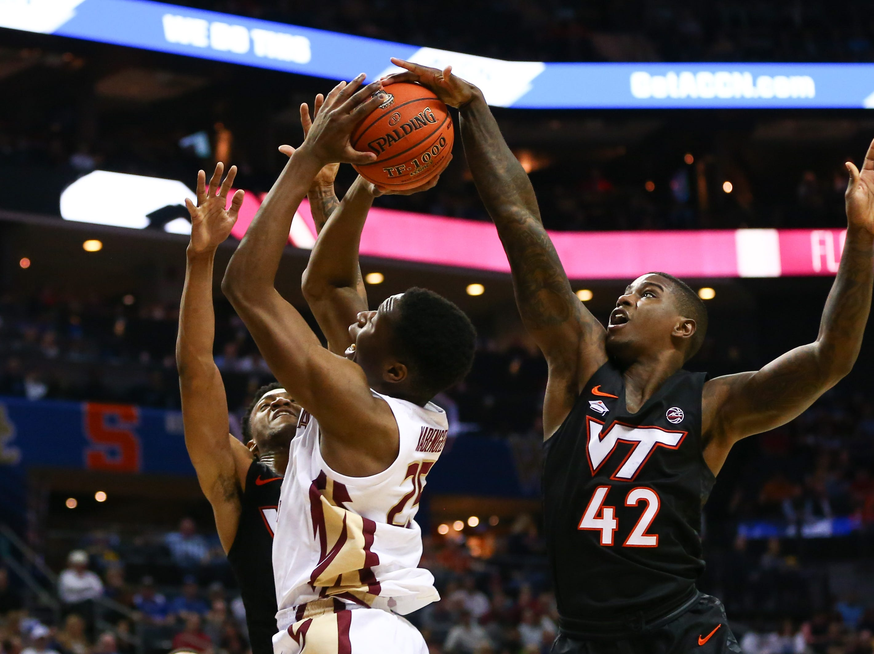 Mar 14, 2019; Charlotte, NC, USA; Virginia Tech Hokies guard Ty Outlaw (42) blocks the shot of Florida State Seminoles forward Mfiondu Kabengele (25) in the first half in the ACC conference tournament at Spectrum Center. Mandatory Credit: Jeremy Brevard-USA TODAY Sports