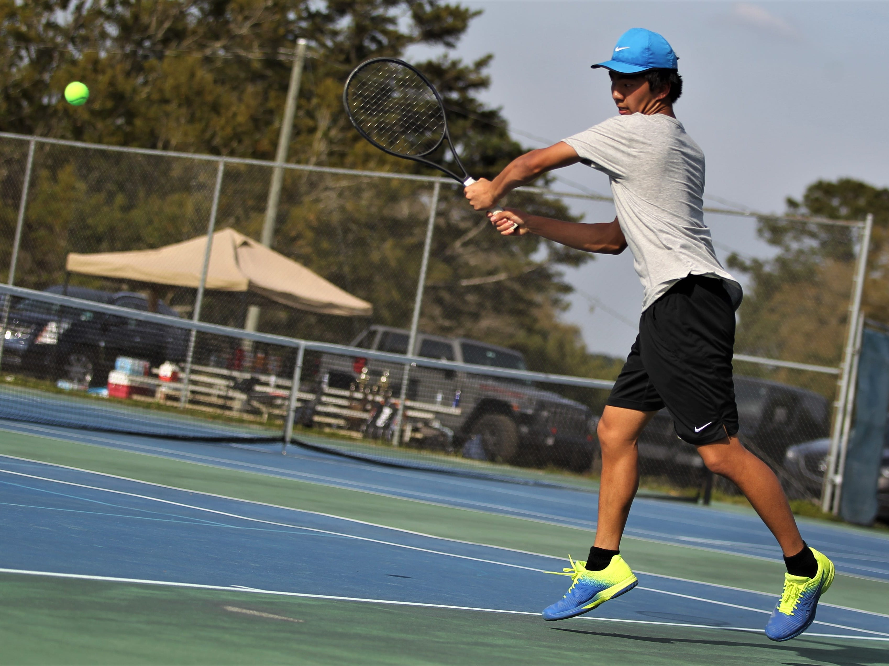 Chiles freshman Brighton Jiang plays during the boys and girls tennis city tournament at Tom Brown Park on March 13, 2019.