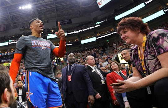 Oklahoma City Thunder's Russell Westbrook gets into a heated verbal altercation with fans in the first half of an NBA basketball game against the Utah Jazz, Monday, March 11, 2019, in Salt Lake City.