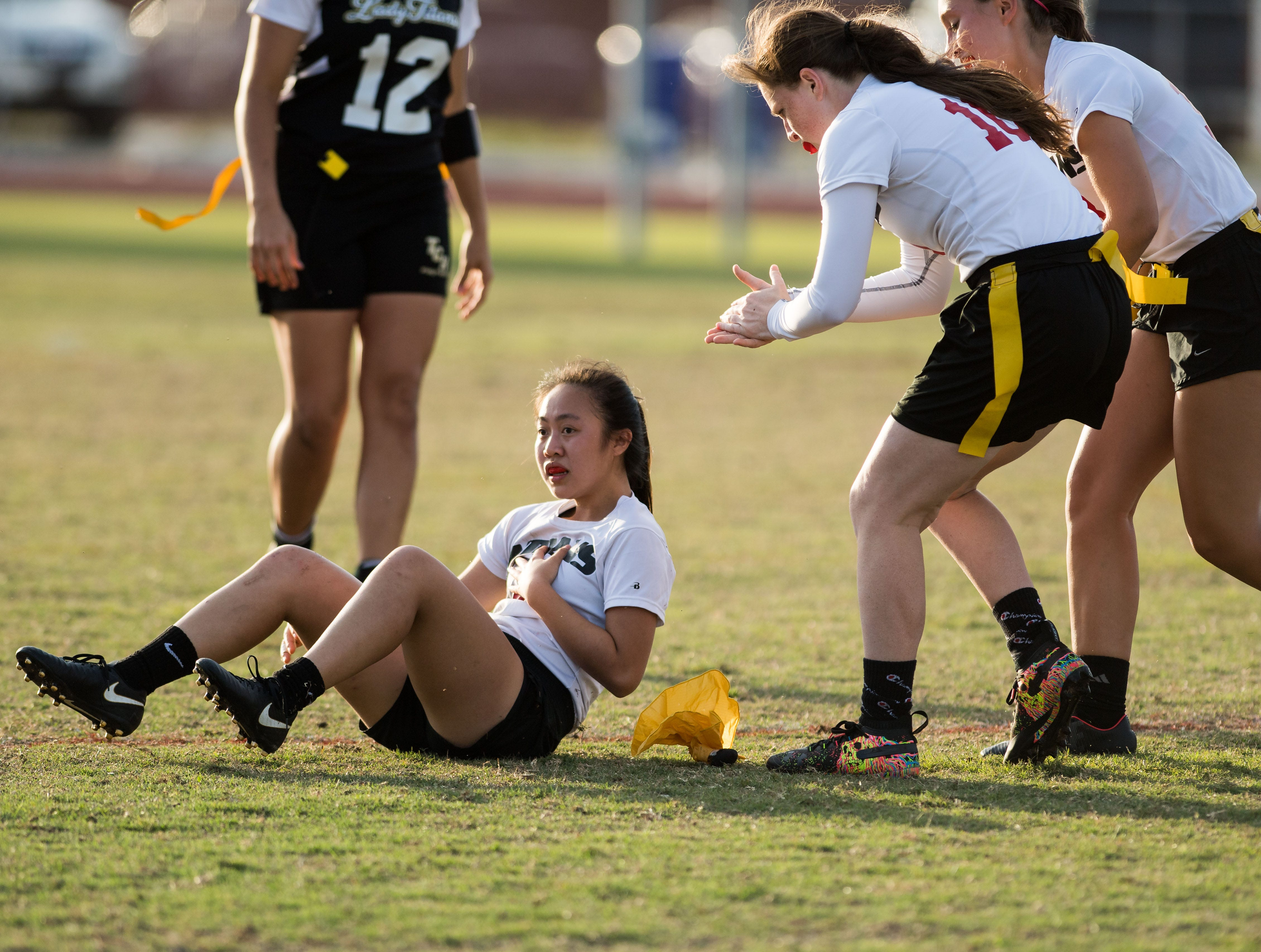 Vero Beach's Jenny Quach recovers after being knocked to the ground after a big reception against Treasure Coast in the fourth quarter at the high school flag football game Wednesday, March 13, 2019, at Vero Beach High School.