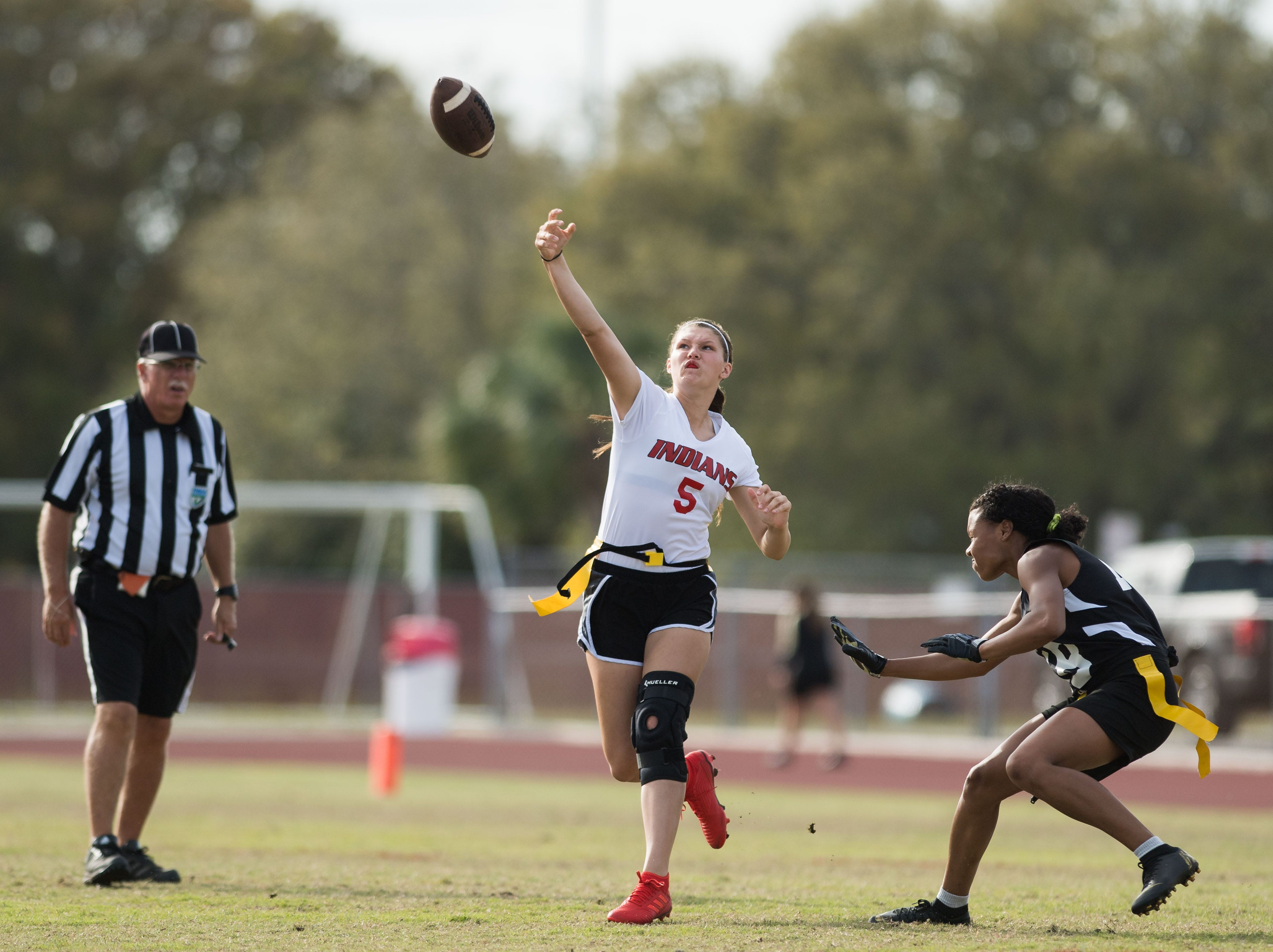 Vero Beach quarterback Taylor Gruwell launches a pass under pressure from Treasure Coast's Angelina Lopez, but there ball is intercepted by Savannah Hawthorne, during the first quarter of the high school flag football game Wednesday, March 13, 2019, at Vero Beach High School.