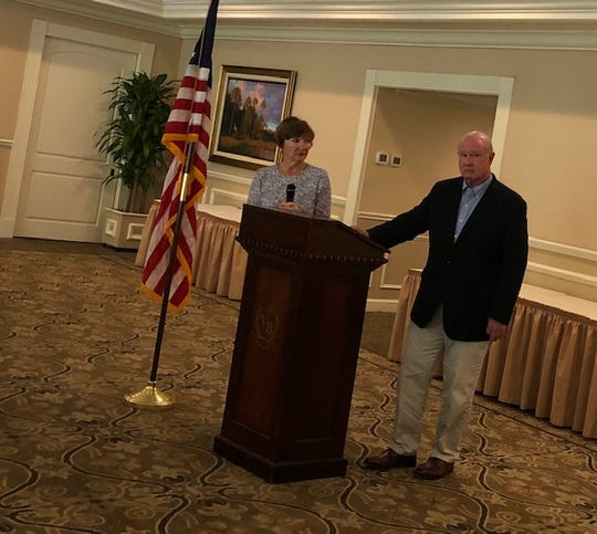 Mary Beth Cunningham and Wayne Hockmeyer speak Wednesday at the monthly meeting of the Taxpayer's Association of Indian River County at the Vero Beach Country Club.