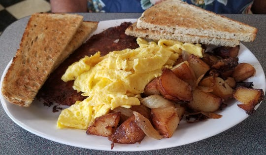 The #7 is corned beef hash with your choice of home fries, hash browns, or grits, two eggs your way, and your choice of toast.