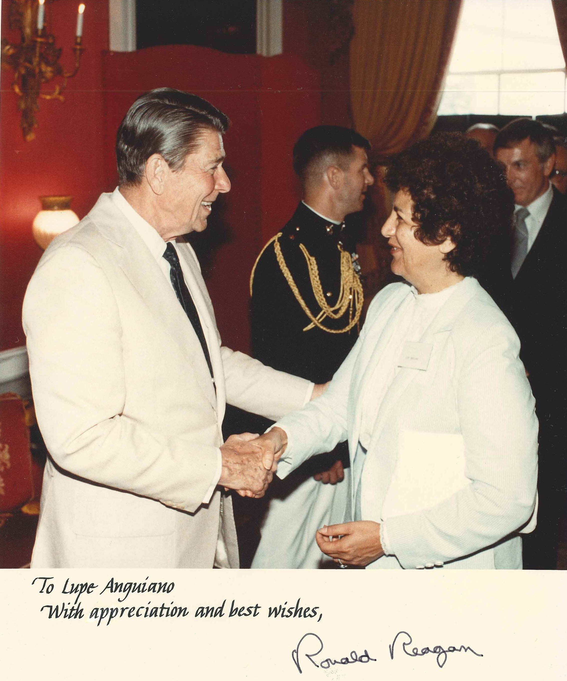 President Ronald Reagan shakes hands with Oxnard activist Lupe Anguiano in an undated photo. She also worked with Presidents Lyndon B. Johnson, Richard Nixon and Jimmy Carter.