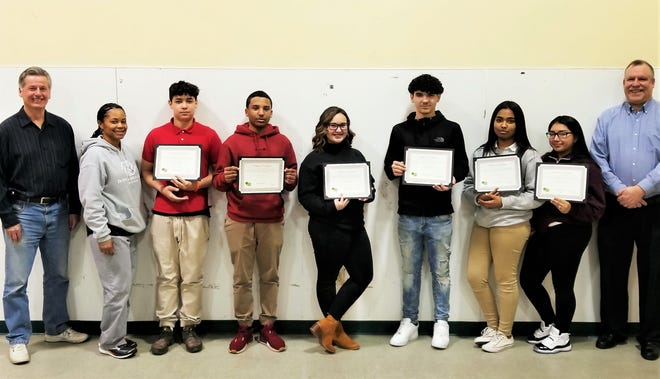Some teens from the Boys & Girls Club of Vineland recently completed the C5 Program Curriculum through the club's CareerLaunch program. They participated in job readiness training, financial literacy education and college preparation. The program is offered in partnership with the Cumberland County Positive Youth Development Coalition and the local Workforce Development Center. Celebrating the completion of the program at the club's Carl Arthur Center are (from left) Alex Kaganzev, club board member, Ashley DuBose, club staff member, Natias Martinez, Angel Acosta, Alaina Martinez, Raymier Martinez, Destiny Acosta, Jocelyn Mendez, and Chris Volker, club director.