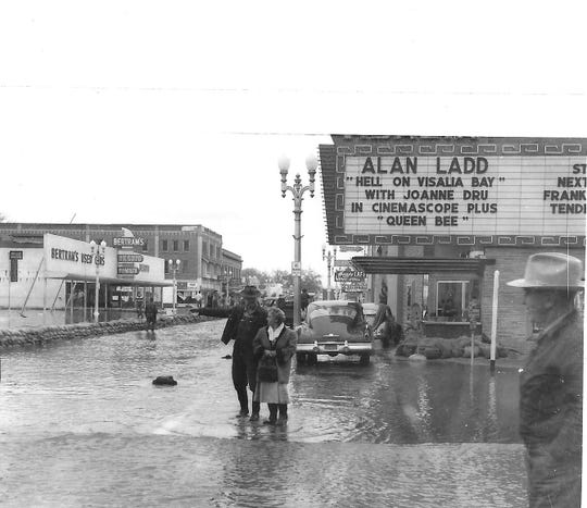 """Hell on Visalia Bay"" posted to the marquee of the Visalia Theater at Main and Garden streets after the city was hit with floodwaters in December 1955 and again in January 1956."