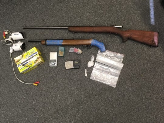 Visalia police found drugs and weapons at a home on Garden Street.