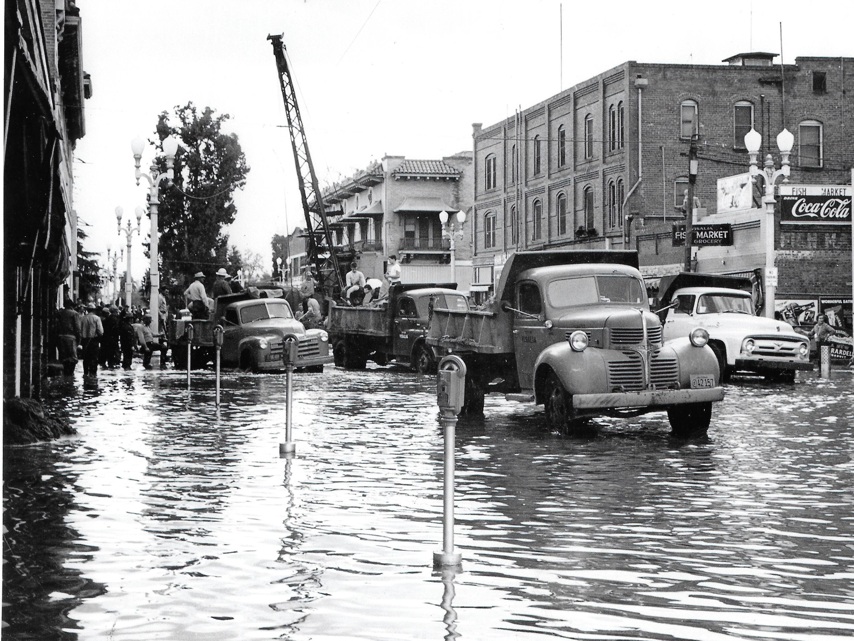 A photo shows the flood scene near Garden and Main Streets after the city was hit with floodwaters in December 1955 and again in January 1956.
