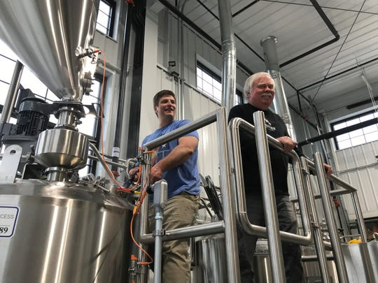 Head Brewer Ben Schreiner, left, and Brewmaster Greg Sperry, right, work on a new recipe special to Mosinee Brewing Company. The brewery was final able to begin making its own beer after receiving its federal license, after a delay from the federal government shutdown.