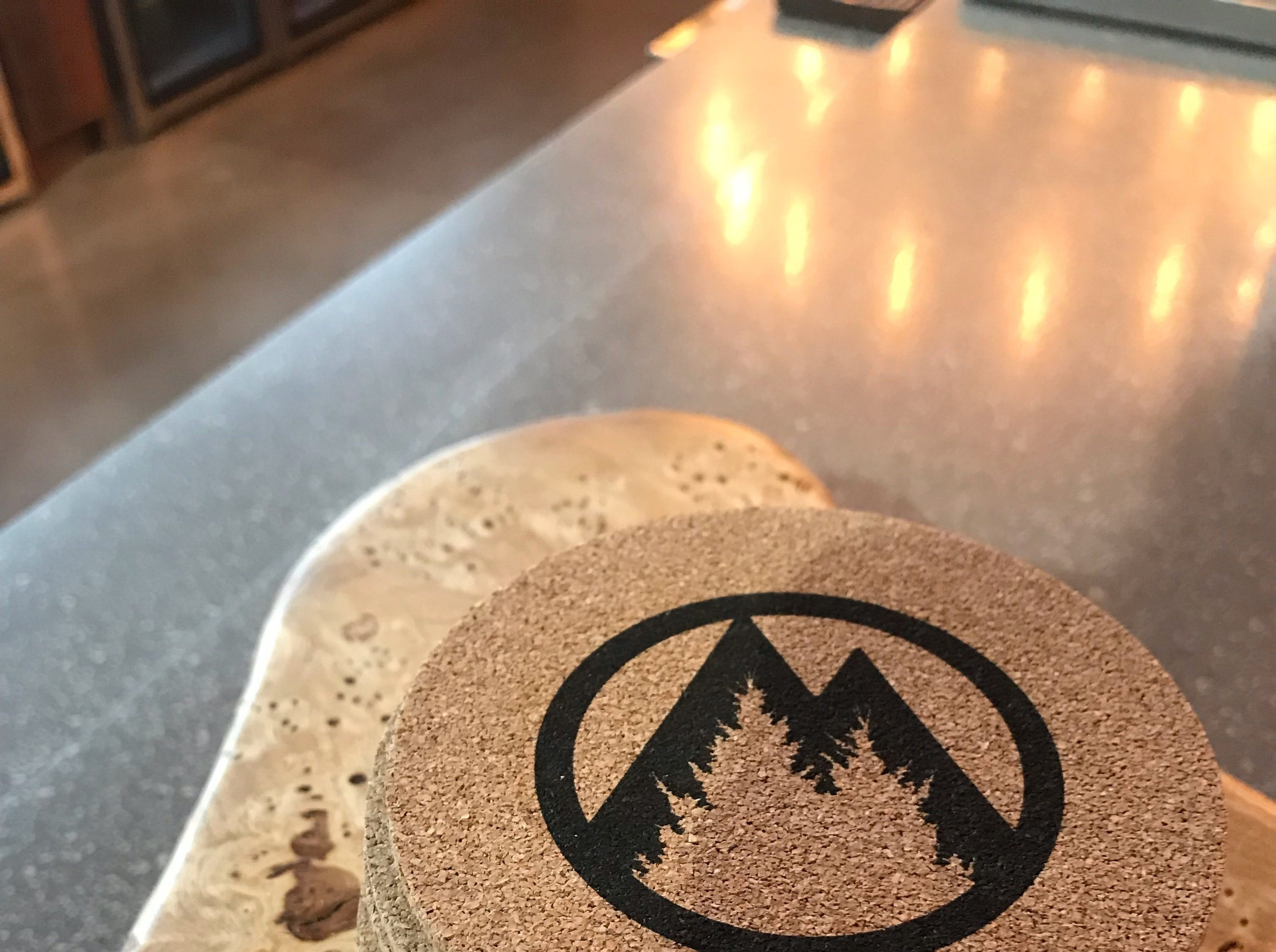 The Mosinee Brewing Company logo is displayed on coasters and napkins around the bar.