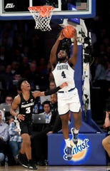Villanova's Eric Paschall (4) drives past Providence's David Duke (3) during the second half of an NCAA college basketball game in the Big East Conference tournament Thursday, March 14, 2019, in New York. Villanova won 73-62.