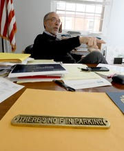 Nyack Mayor Don Hammond talks about parking in his Village Hall office March 14, 2019. The plaque on his desk, a holdover from Nyack mayors past, suggests that parking has always been an issue in the river town. But the most recent parking controversy could result in the village pulling its accounts from a local bank branch.