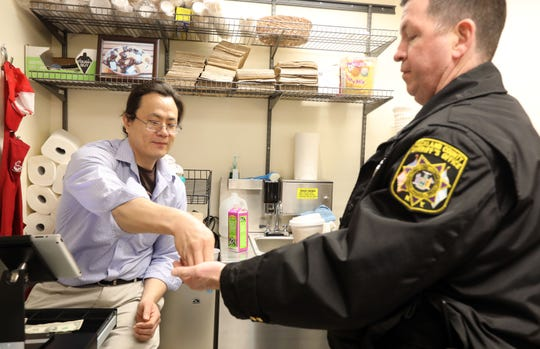 Army veteran Samuel Jung, 37, who served in Iraq, gives Sheriff's Officer Sean Moloney his change at the Independence Cafe in the Rockland County Courthouse March 14, 2019 in New City. The Independence Cafe, owned by BRiDGES, the independent living center for Rockland, was designed to employ veterans and people with disabilities.