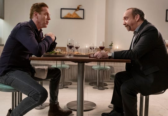 "Damian Lewis as ""Axe"" and Paul Giamatti as Chuck Rhoades  in Showtime's ""Billions."" Season 4 debuts March 17."