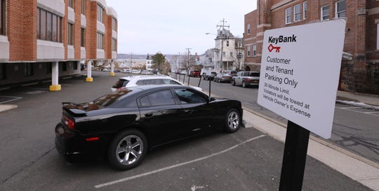 A parking for customers only sign at Key Bank on Broadway in Nyack March 14, 2019.