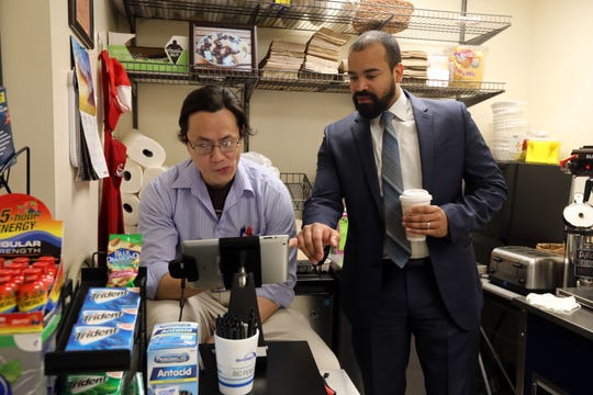 BRiDGES executive director Carlos Martinez chats with Army veteran Samuel Jung, 37, who served in Iraq, at the Independence Cafe in the Rockland County Courthouse March 14, 2019 in New City. The Independence Cafe, owned by BRiDGES, the independent living center for Rockland, was designed to employ veterans and people with disabilities.