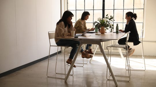 Co-working spaces flourish in the suburbs, drawing moms who seek quiet and camaraderie