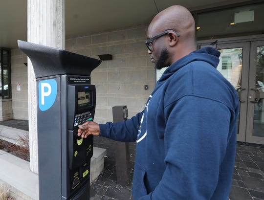 Rock Hoffer of Nyack uses a metered parking station behind the Nyack Library on March 14, 2019. The new meter, which has an app and is based on a car's license plate, doesn't require parkers to display a receipt on their dashboard. Nyack will replace its 10-year-old Muni Meters with Parkeon plate-based meters this spring.