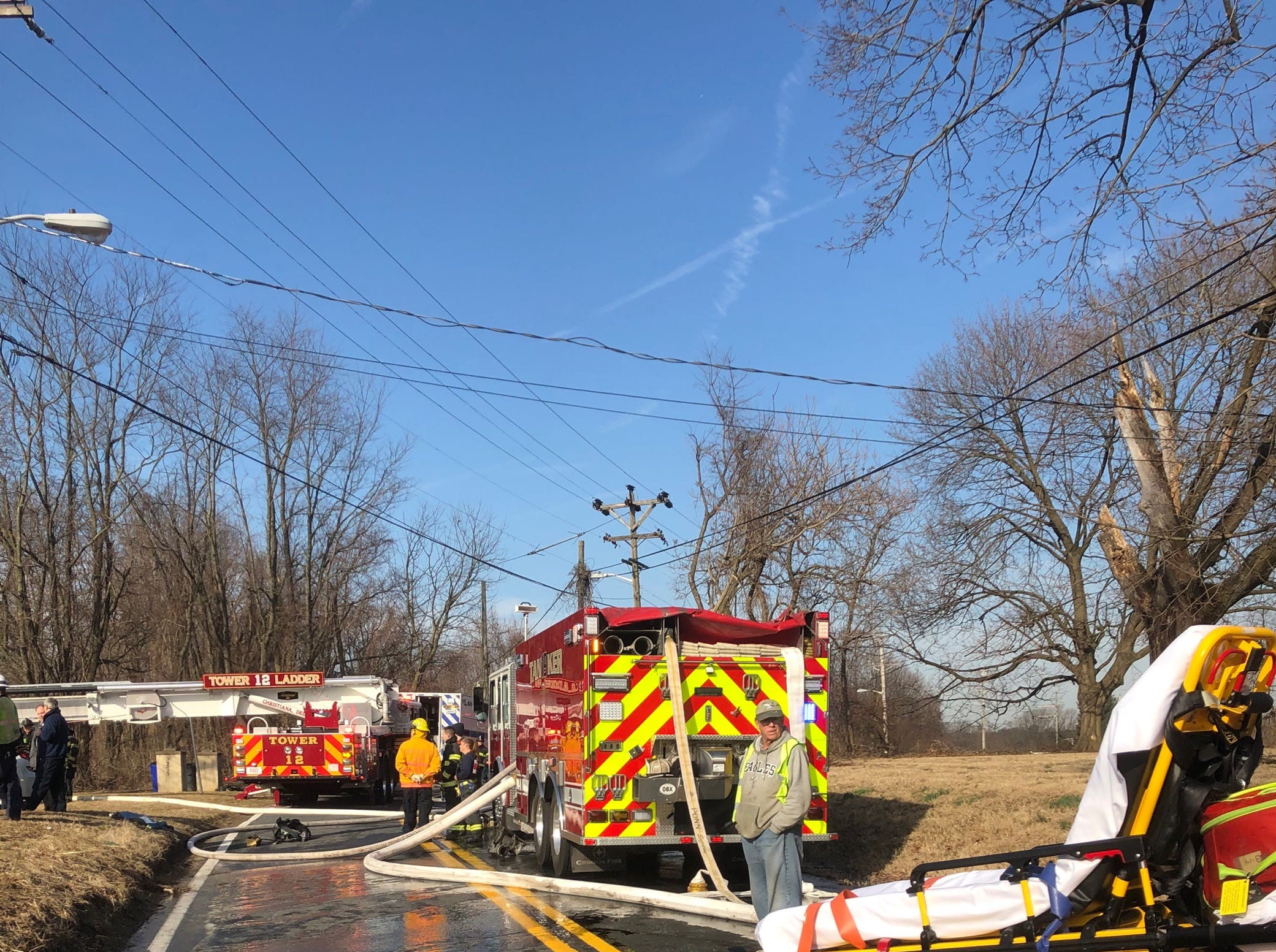 Firefighters work at the scene of a blaze on Thursday at a home in Milltown.