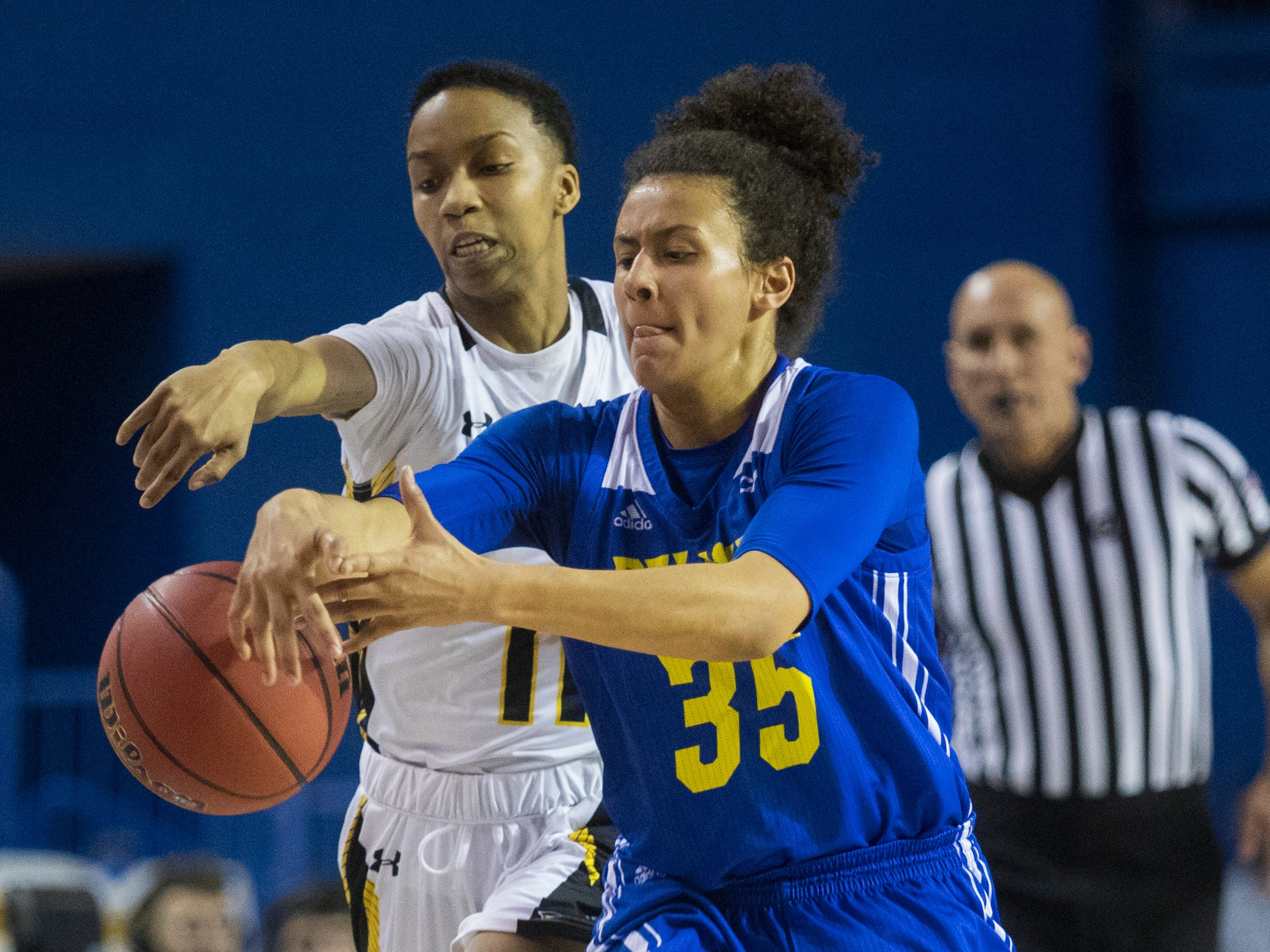 Delaware's Alison Lewis (35) races for possession against Towson's Q. Murray (11) Thursday night against Towson in the CAA quarterfinals. Towson defeated Delaware 59-49.