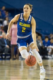 Delaware's Abby Gonzales (2) dribbles downcourt during their CAA matchup against Towson Thursday afternoon at the Bob Carpenter Center.