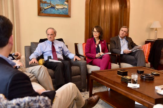 Sen. Tom Carper, left, and Rep. Lisa Blunt Rochester, center, meet with Guatemalan officials during a Congressional visit last month.