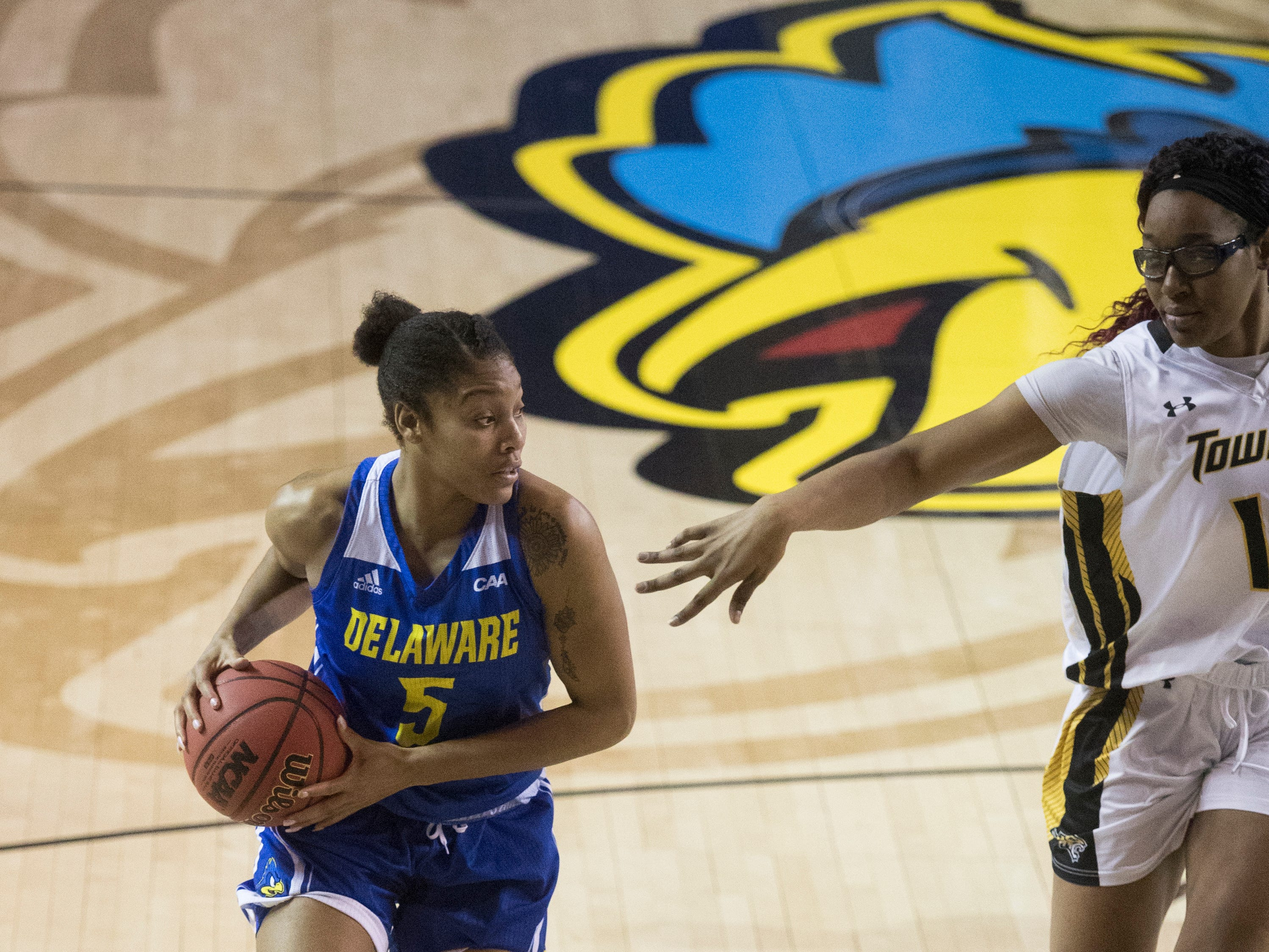 Delaware's Makeda Nicholas (5) looks for an open teammate Thursday night against Towson in the CAA quarterfinals. Towson defeated Delaware 59-49.