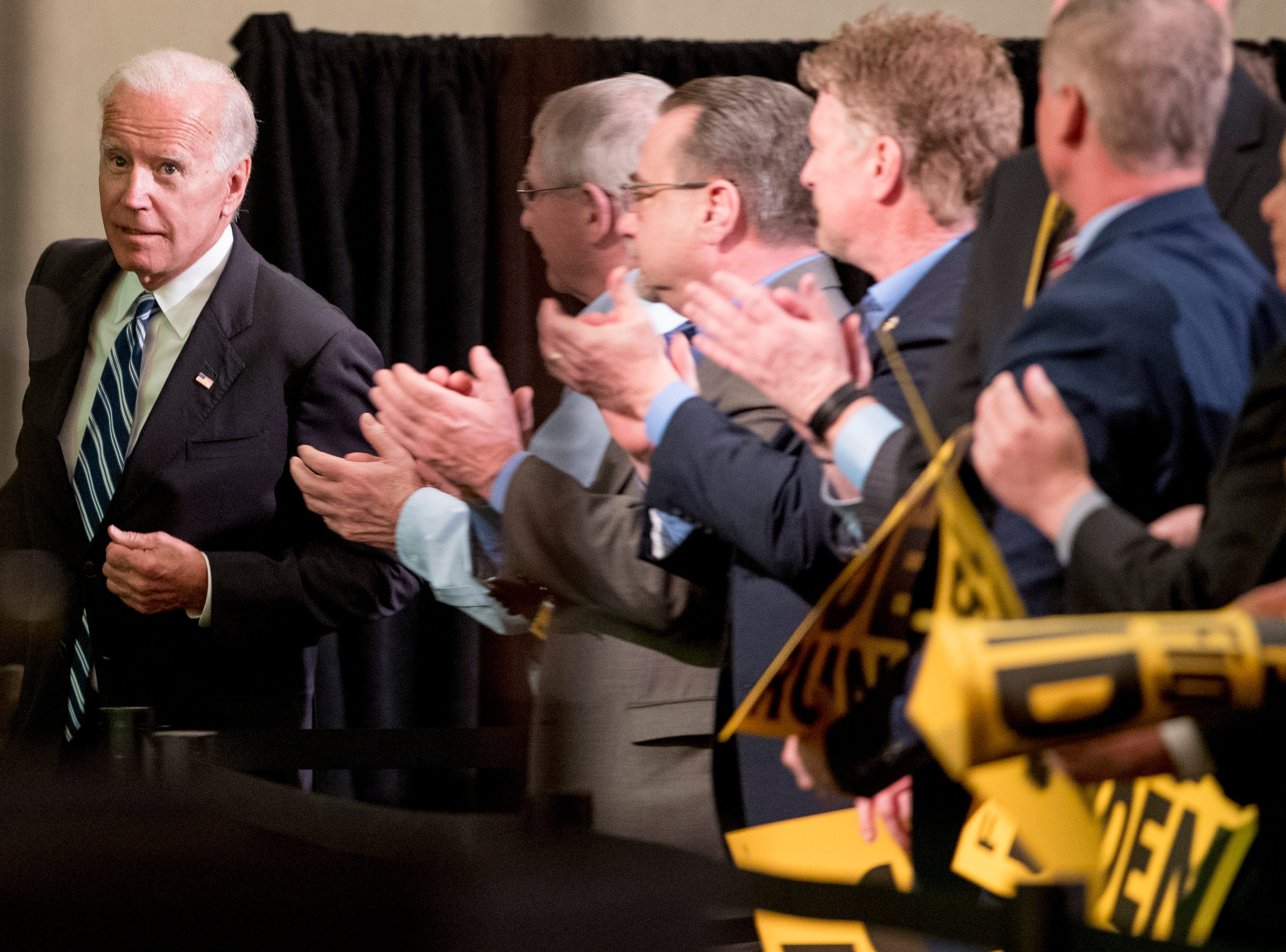 Former Vice President Joe Biden takes the stage to speak to the International Association of Firefighters at the Hyatt Regency on Capitol Hill in Washington, Tuesday, March 12, 2019, amid growing expectations he'll soon announce he's running for president. (AP Photo/Andrew Harnik)