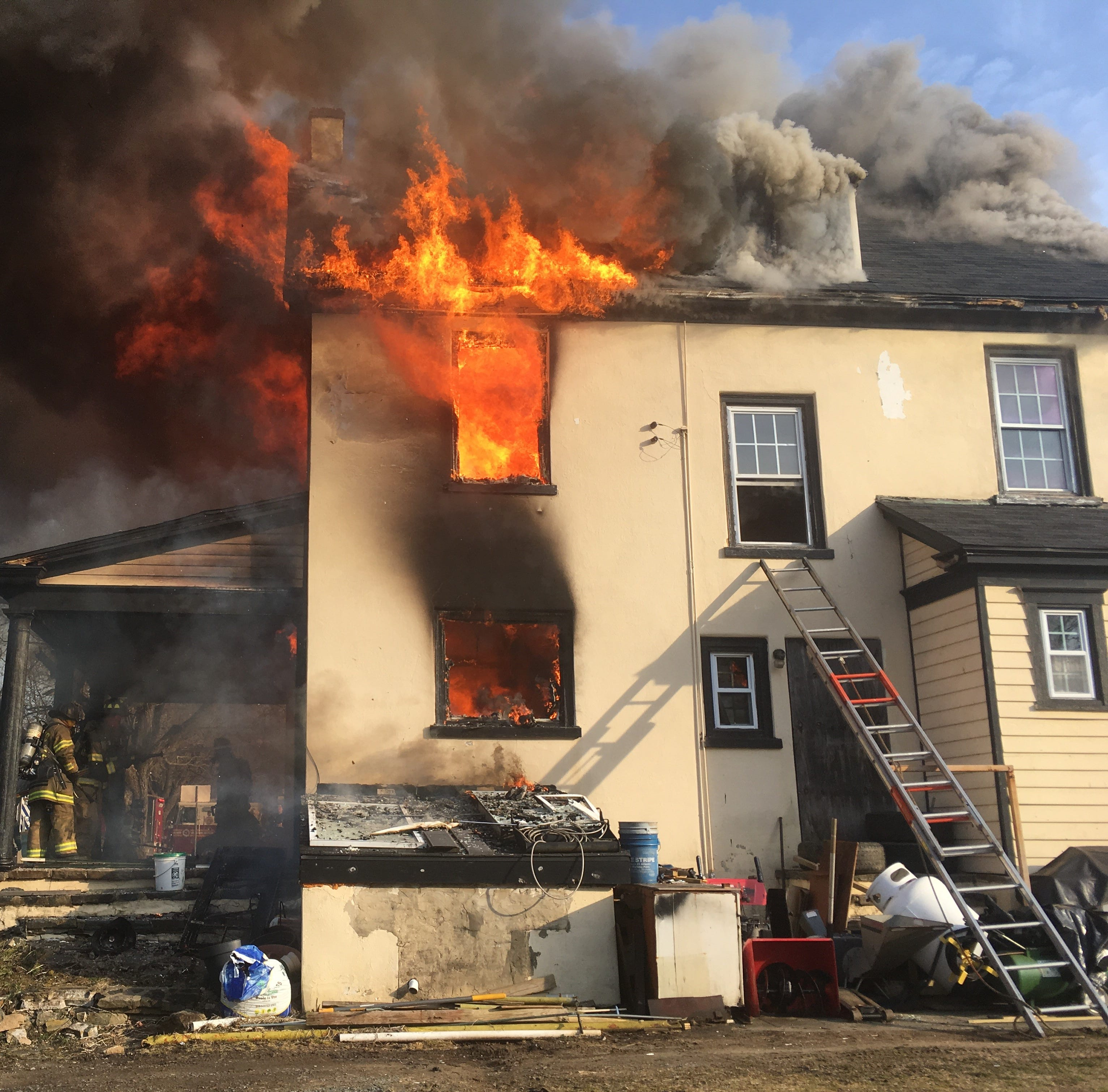 Where was the water when a firefighter was trapped in burning house?