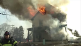 A firefighter was injured Thursday when a home was engulfed in flames on Mill Creek Road in Milltown.   Video provided by John J. Jankowski Jr.  3/14/19