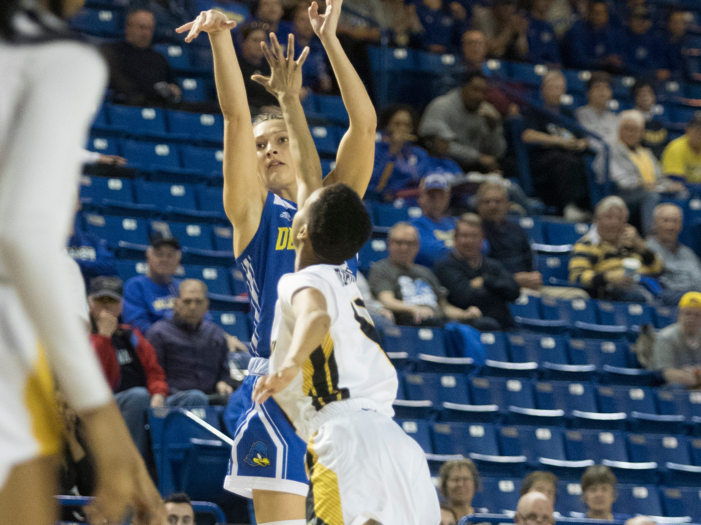 Delaware's Abby Gonzales (2) shoots a jump shot Thursday night against Towson in the CAA quarterfinals. Towson defeated Delaware 59-49.