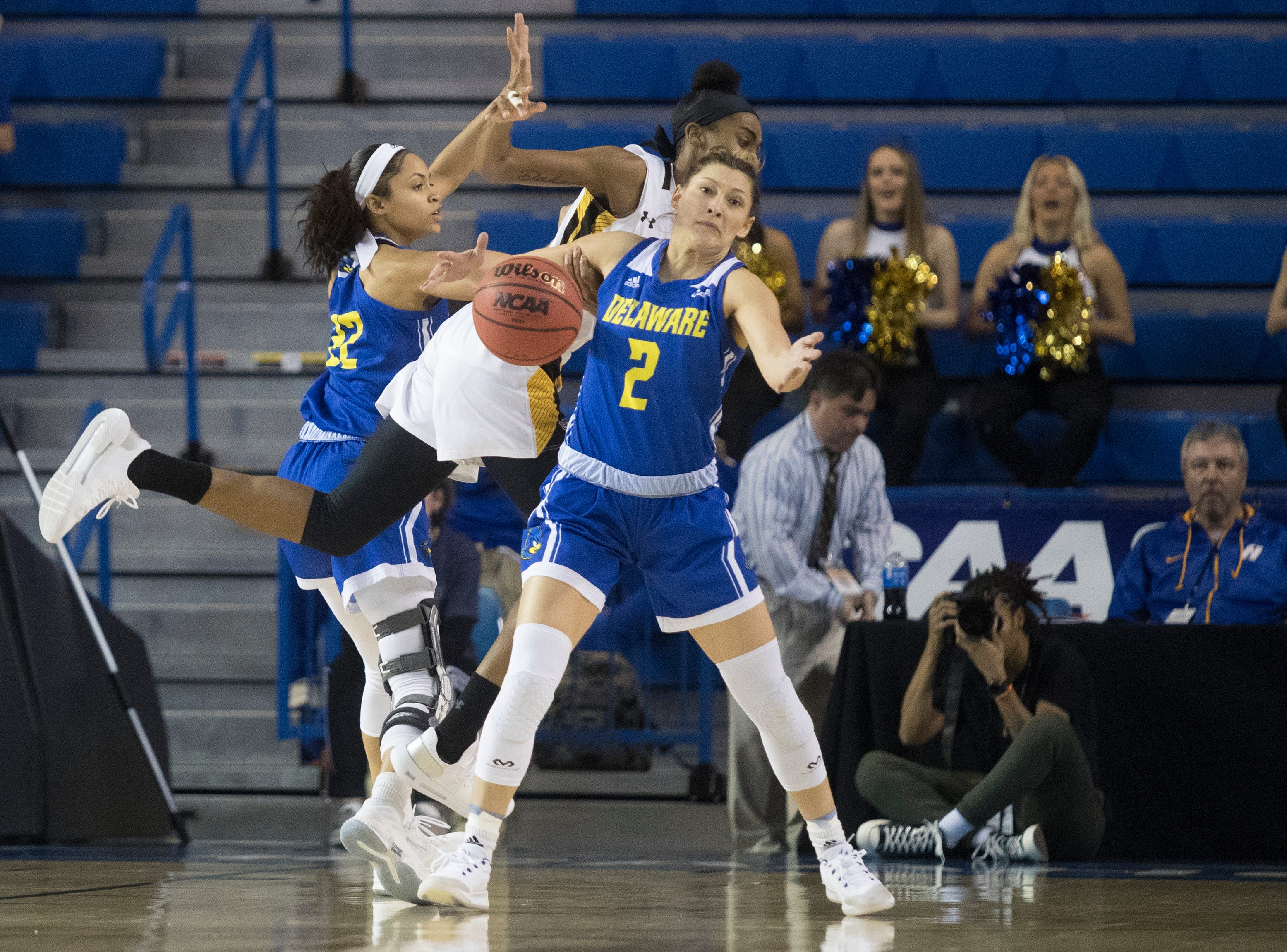Delaware's Samone DeFreese (22) and Abby Gonzales (2) struggle to gain possession Thursday night against Towson in the CAA quarterfinals. Towson defeated Delaware 59-49.