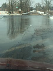 Standing water at the intersection of Edgewood Drive and State 13, just south of Adams, on Thursday, March 14, 2019.