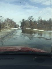 Water covers 11th Avenue, just south of Adams, on Thursday, March 14, 2019.