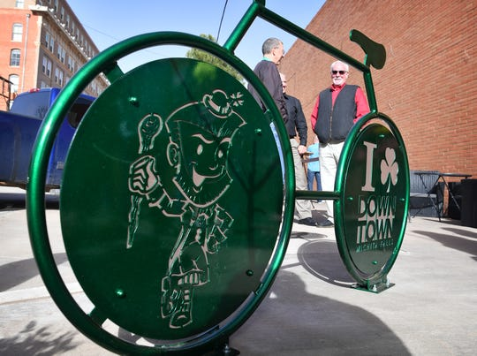 A St. Patrick's Day Festival dancing leprechaun and shamrock are part of the latest sculptural bike rack design for downtown Wichita Falls. This is the fifth bike rack in the area and is located next to the Gypsy Kitchen & Bar on Indiana.