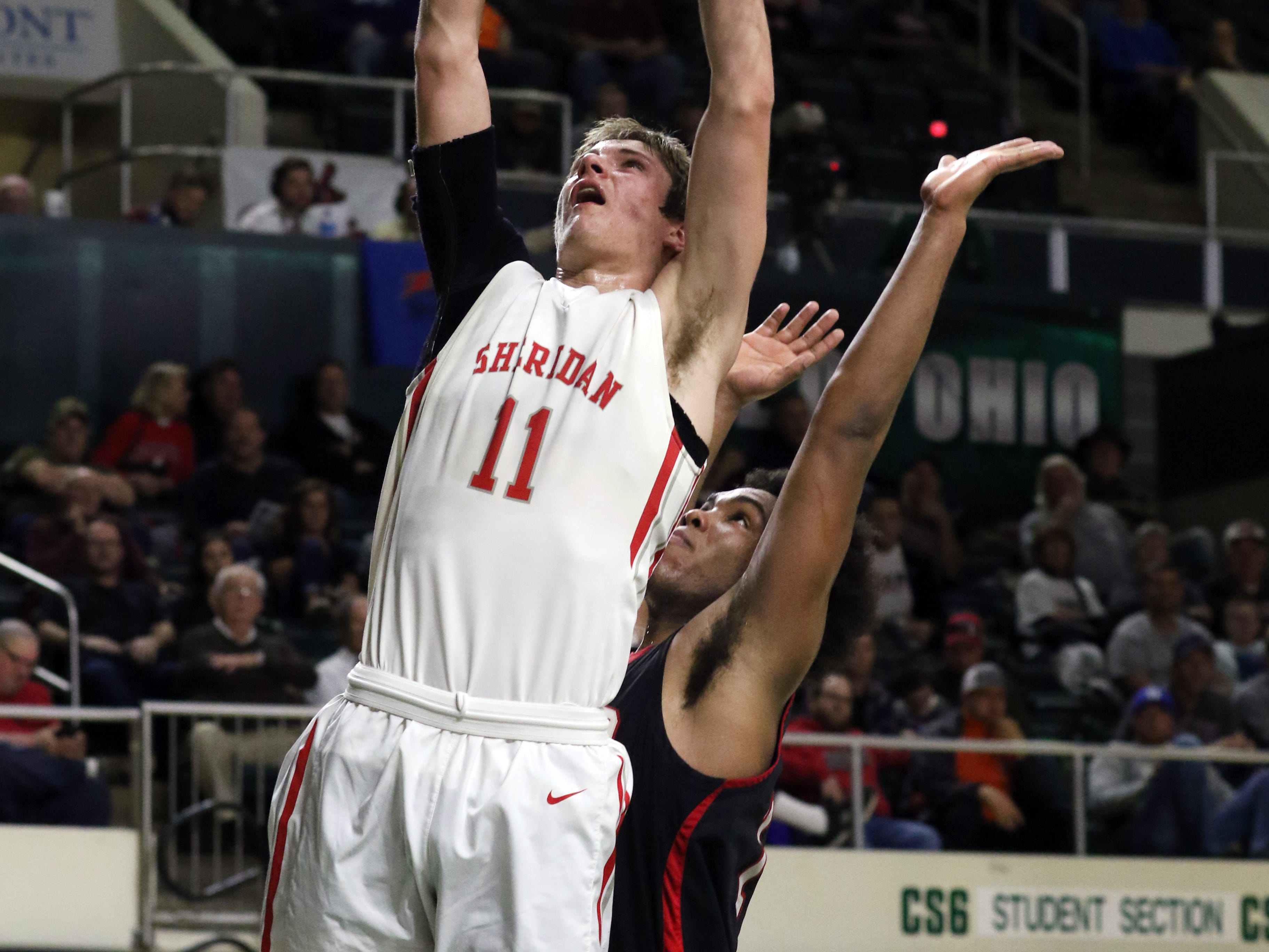 Sheridan's Luken Hill puts up a shot against Steubenville in the Division II regional semifinals Wednesday in Athens.