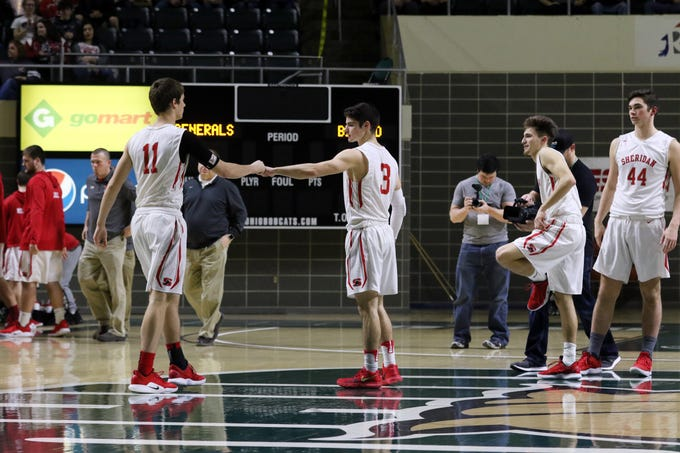 Sheridan's Ethan Heller greets Luken Hill as the Generals take the floor to take on Steubenville in the Division II regional semifinals Wednesday in Athens.