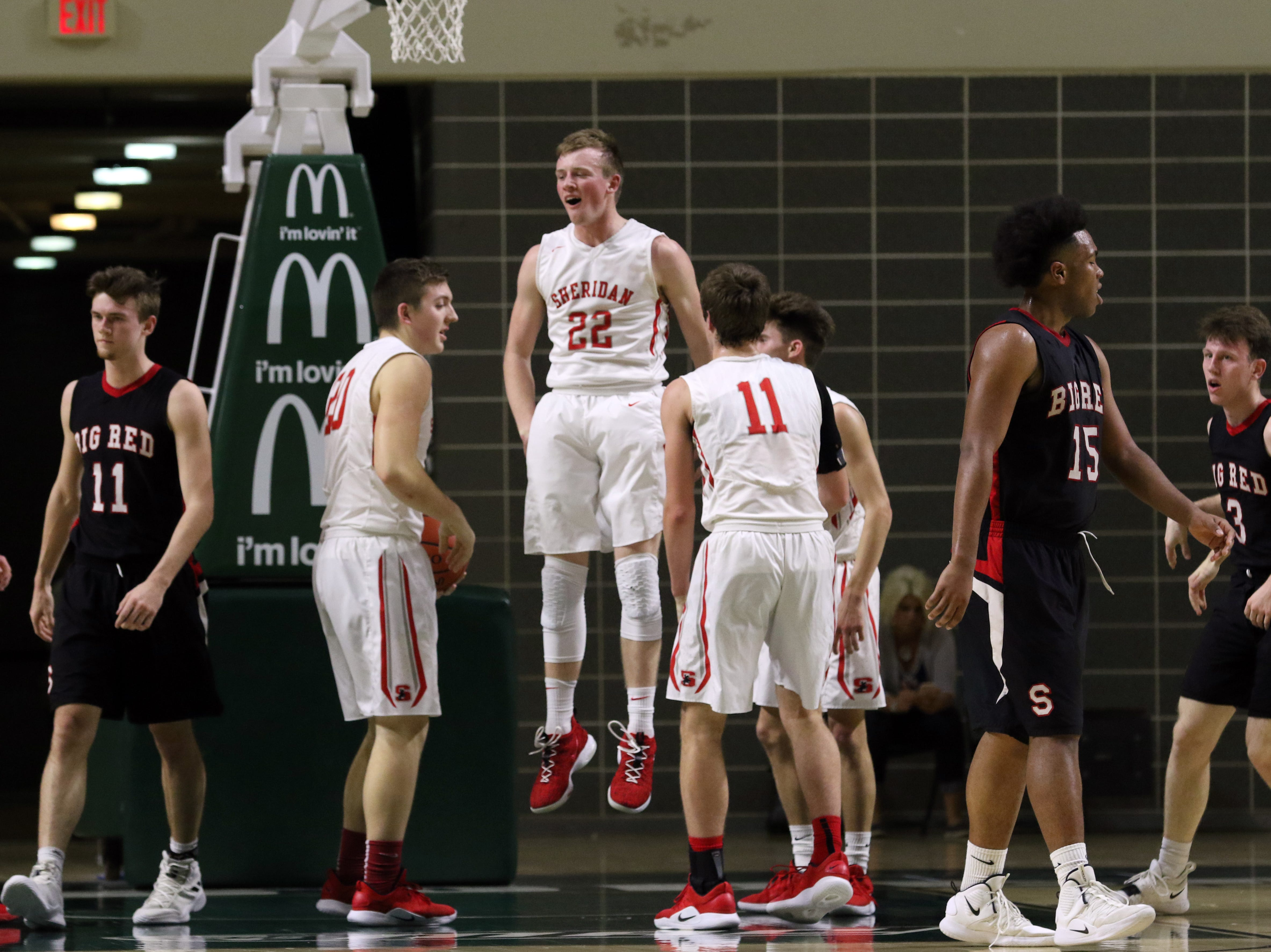 Sheridan's Landen Russell hops to his feet after drawing a charge against Steubenville in the Division II regional semifinals Wednesday in Athens.