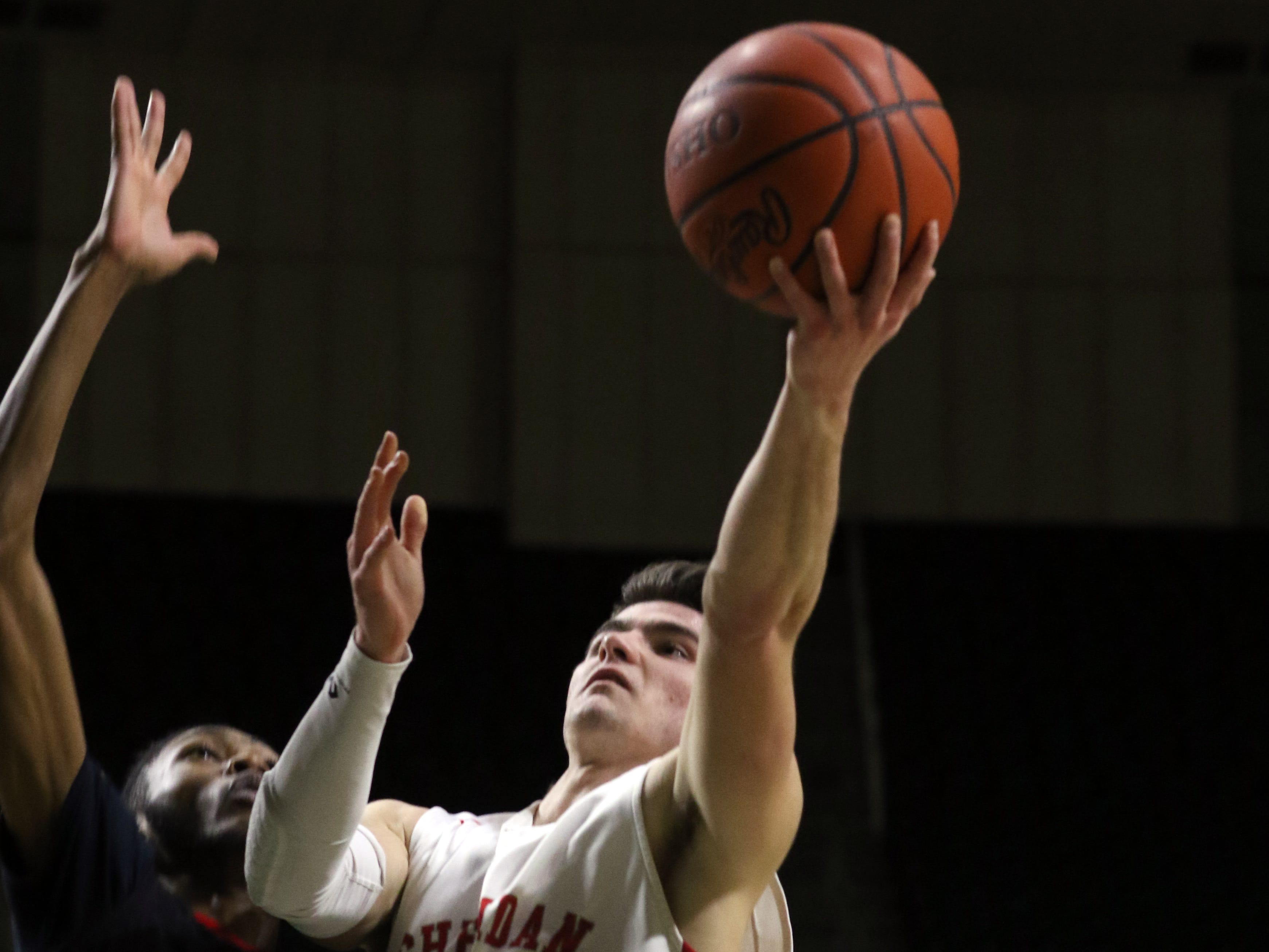 Sheridan's Ethan Heller puts up a shot against Steubenville in the Division II regional semifinals Wednesday in Athens.
