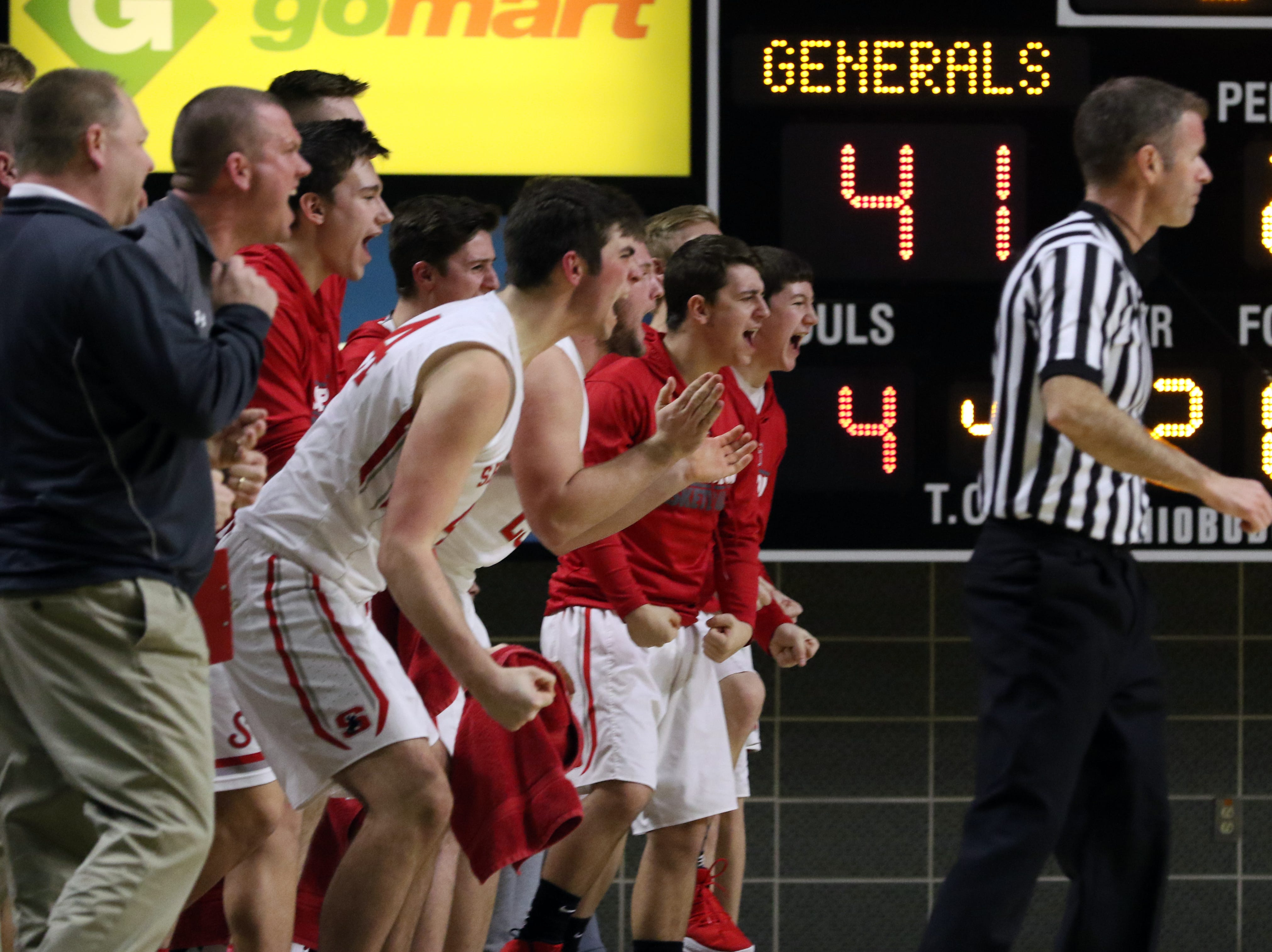The Sheridan bench celebrates a play against Steubenville in the Division II regional semifinals Wednesday in Athens.
